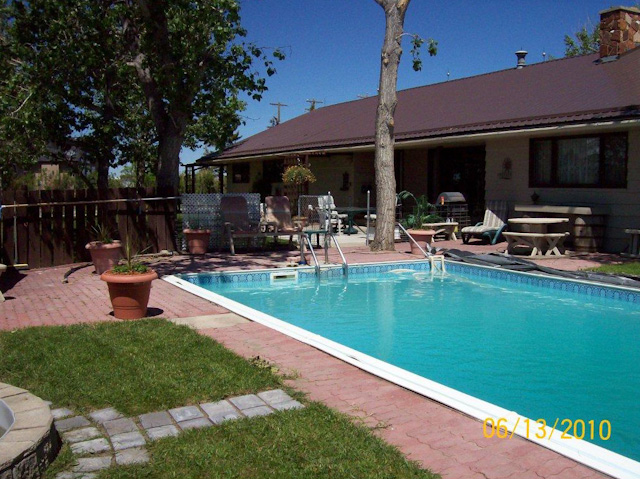 acres with 2500 sq ft house and swimming pool claresholm 469 000